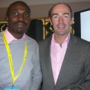 Tomi Ogunlesi with Michael Wall, Global CEO Lowe